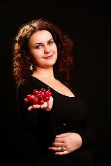 Woman With Grapes. Royalty Free Stock Photo