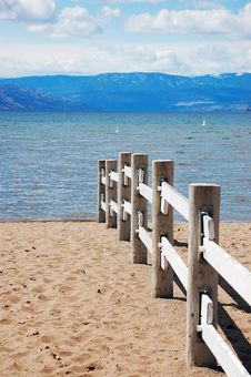Free Sandy Beach With Wooden Fence Stock Photos - 13725583