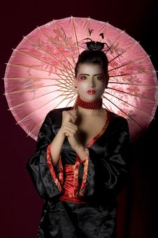 Free Sexy Young Geisha Holding A Painted Umbrella Royalty Free Stock Photo - 13727695