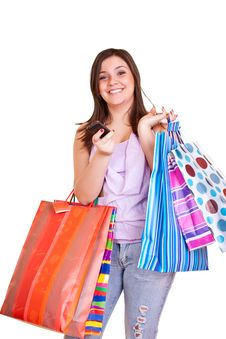 Happy  Girl Holding Shopping Bags And Cell Phone Stock Images