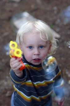 Blond Little Boy With Bubble Gun Stock Images