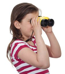 Girl Looking Through A Pair Of Binoculars Royalty Free Stock Photography