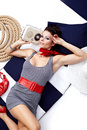 Free Pin-up Woman Laying And Listening Music Stock Photo - 13733800