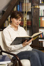 Free Pretty Senior Woman Sitting And Reading A Book Stock Photos - 13737133