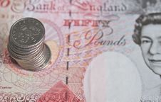 Free Five Pences Stacked On A Fifty Pound Note Stock Images - 13730804