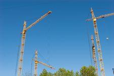 Free Four Hoisting Cranes Stock Photos - 13731253