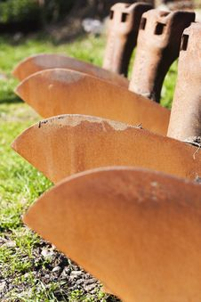 Rusted Plough Array Royalty Free Stock Photography