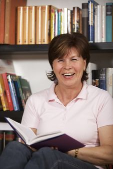 Free Senior Woman Laughing And Reading Stock Image - 13731851