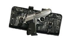 Free Silver Gun And Black Clutch Purse Stock Photos - 13732453