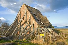 Free Derelict House Propped Up By Planks. Stock Image - 13733131