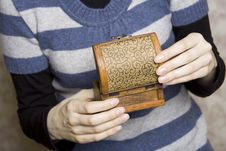 Free Hands Holding A Decorative Wooden Box Stock Photography - 13734802