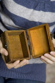 Free Hands Holding A Decorative Wooden Box Royalty Free Stock Photo - 13734935