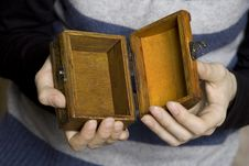 Free Hands Holding A Decorative Wooden Box Royalty Free Stock Images - 13735219