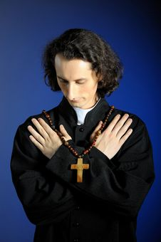Praying Priest With Wooden Cross Stock Image