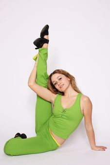 Free Young Woman Doing Stretching Exercise Royalty Free Stock Images - 13735649