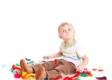 Free Little Boy Is Sitting On A Flow With Feathers Stock Photography - 13735892