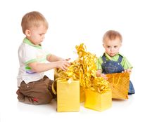 Free Two Boys With Gifts Royalty Free Stock Photography - 13735957