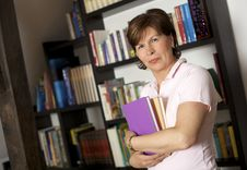 Free Friendly Senior Woman Carrying Books Royalty Free Stock Image - 13736736