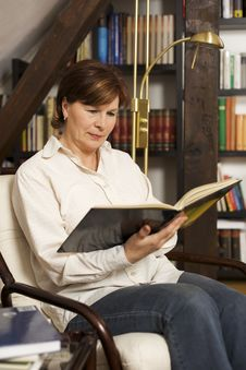 Pretty Senior Woman Sitting And Reading A Book Stock Photos