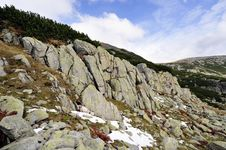 Free High Mountains Scape With Boulders And Snow Royalty Free Stock Photography - 13737737