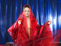 Free Woman In Red Silk On Blue Background Royalty Free Stock Photography - 13741457