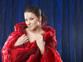 Free Young Woman In Red Silk On Blue Background Royalty Free Stock Image - 13741476