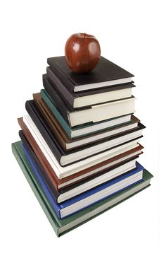 Free Pile Of Books & Apple Isolated Against White Royalty Free Stock Image - 13740706