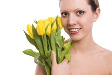 Young Woman With Yellowtulips Stock Images