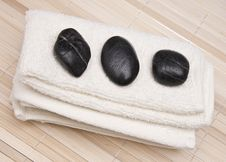 Towel With Massage Stones Royalty Free Stock Image