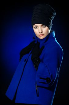 Free Lady  In A Blue Topcoat Royalty Free Stock Image - 13747146