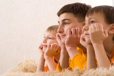 Three Brothers In Orange Shirts Royalty Free Stock Images