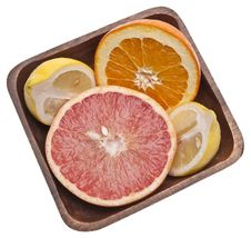 Bowl Of Sliced Citrus Stock Photos
