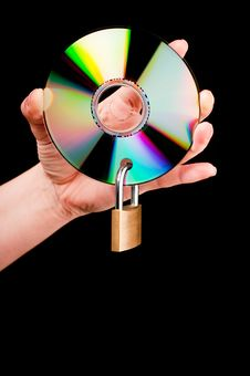 Free A Hand Holding A CD With Lock Stock Photo - 13749990