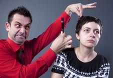 Free Man Examining Woman S Hair Stock Photography - 13750552