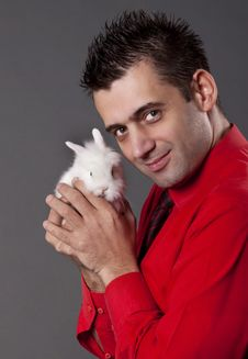 Free Handsome Young Man Holding White Rabbit Stock Image - 13750571