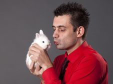 Free Handsome Young Man Holding White Rabbit Royalty Free Stock Image - 13750586