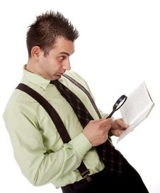 Businessman Reading A Book With Magnifying Glass Royalty Free Stock Photo