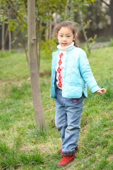Free Cute Little Asian Girl On Grass Stock Images - 13752704