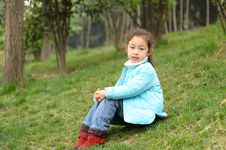 Cute Little Asian Girl On Grass Royalty Free Stock Photography