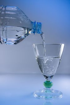 Bottle And Glass Of Mineral Water Royalty Free Stock Photos