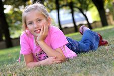 Free Smiling Girl On The Grass. Royalty Free Stock Photo - 13753785