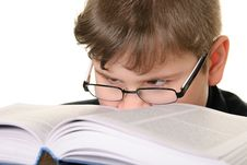 Boy Wearing Spectacles Attentively Reads Book Royalty Free Stock Image