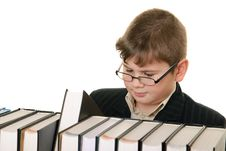 Free Boy Wearing Spectacles Attentively Chooses  Book Stock Image - 13754051