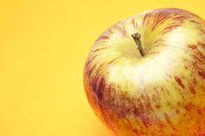 Free Apple On Yellow Stock Photos - 13754503