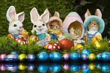 Easter Bunnies And Chocolate Easter Eggs Stock Photo