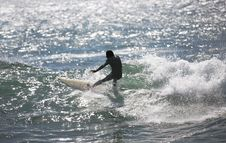 Surfer Rides A Wave Royalty Free Stock Photo