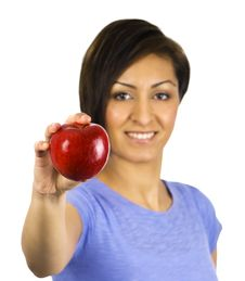Free Young, Ethnic Woman Holding A Red Apple Stock Images - 13755284
