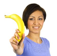 Free Smiling Young Woman Holds A Banana Stock Photo - 13755290
