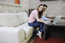 Young Couple Working On Laptop At Home Stock Photo