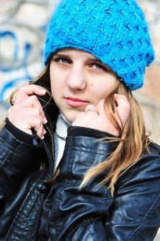 Teen Girl Wearing Blue Hat Stock Images